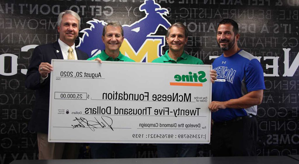 On hand for the donation are from left, James Landreneau, McNeese head softball coach, Dennis Stine, Stine CEO, David Stine, Stine vice president of marketing and merchandising, and Dr. Wade Rousse, McNeese vice president for university advancement and dean of the college of business.